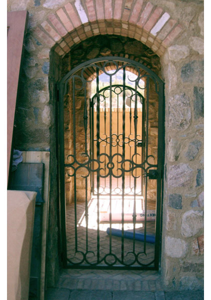 mediterranean exterior by Colletti Design Iron Doors