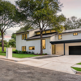 Inspiration for a mid-sized contemporary white two-story mixed siding exterior home remodel in Austin with a metal roof