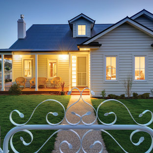 Example of a mid-sized trendy white one-story concrete fiberboard exterior home design in Melbourne