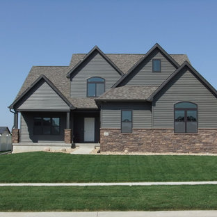 Example of a large arts and crafts gray two-story mixed siding gable roof design in Cedar Rapids