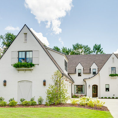 Transitional white two-story brick exterior home photo in Birmingham with a shingle roof