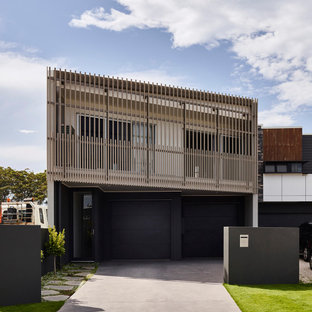 Design ideas for a small contemporary two-storey black exterior in Sunshine Coast.