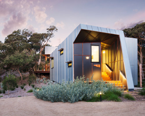 Inspiration For An Industrial Exterior In Melbourne With Metal Siding And A  Shed Roof.