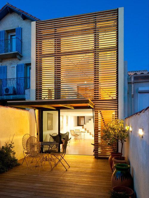 photos d 39 architecture et id es d co de petites fa ades de maisons avec un toit plat. Black Bedroom Furniture Sets. Home Design Ideas