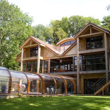 Construction d'une maison ossature bois avec piscine couverte