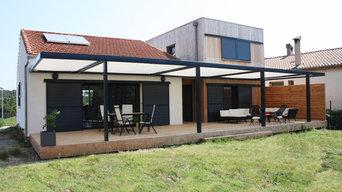 Extension contemporaine à ossature bois et rénovation d'une maison d'habitation