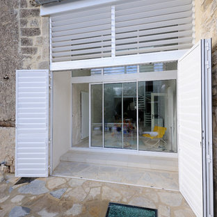 Example of a tuscan white metal exterior home design in Montpellier
