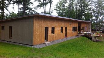 Maison ossature bois dans la forêt