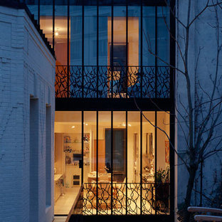Mid-sized transitional white three-story metal exterior home photo in Paris