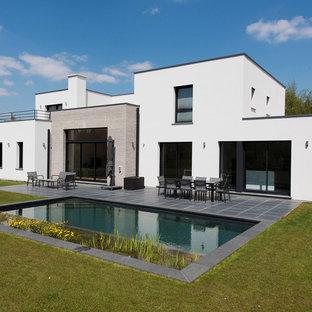 リールの中くらいのコンテンポラリースタイルのおしゃれな家の外観 (コンクリートサイディング) の写真