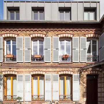 vue façade après travaux - surélévation zinc