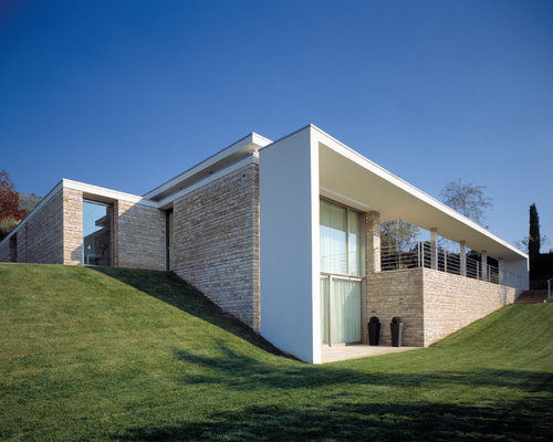 Foto e idee per facciate di case facciata di una casa for Piani di casa di architettura