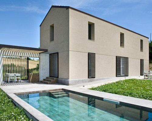 Foto e idee per facciate di case facciata di una casa for Piccoli piani di casa in cemento