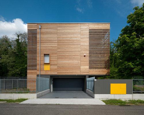 Elegant esempio della facciata di una casa a tre o pi for Bloccare i piani di costruzione del garage