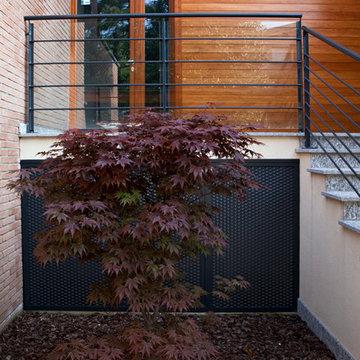 Costruire con legno e mattoni. Edificio residenziale a Rodano - MQ 800