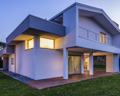 Ideas para fachadas dise os de fachadas con tejado a dos for Tejados de madera a dos aguas
