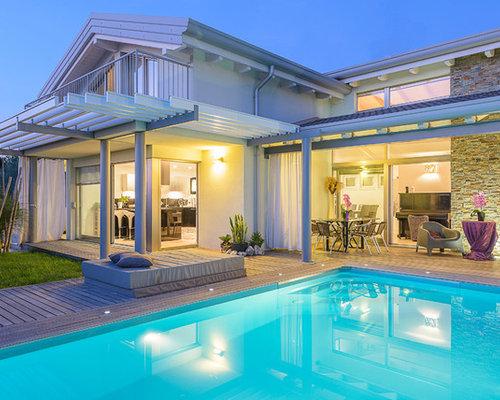 Foto e idee per facciate di case facciata di una casa for Tetti di case moderne