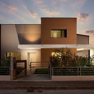 Modelo de fachada moderna, de dos plantas, con tejado plano
