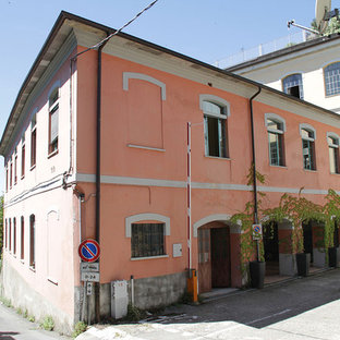Example of a tuscan pink two-story exterior home design in Milan
