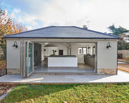 Foto e idee per facciate di case facciata di una casa for Piani di casa porte cochere