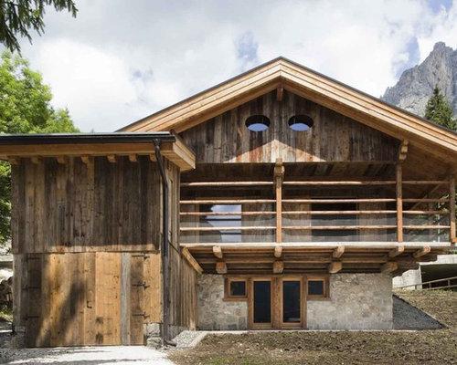 Foto e idee per facciate di case facciata di una casa for Case in legno e pietra