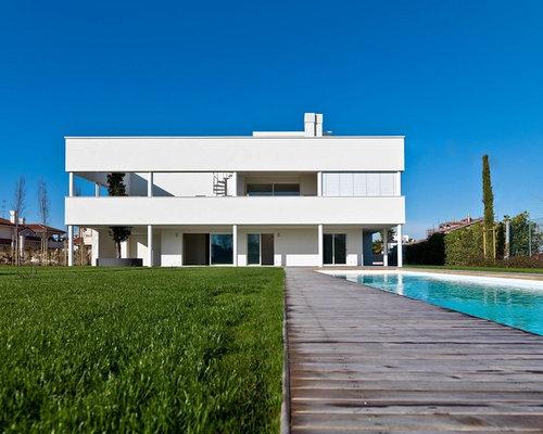 Foto e idee per facciate di case facciata di una casa for Casa moderna tetto piatto