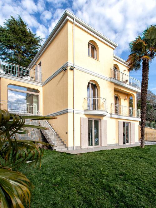 Foto e idee per facciate di case facciata di una casa for Foto casa classica