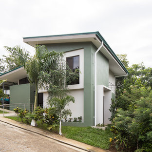 Inspiration for a modern green split-level concrete house exterior remodel in Other with a metal roof