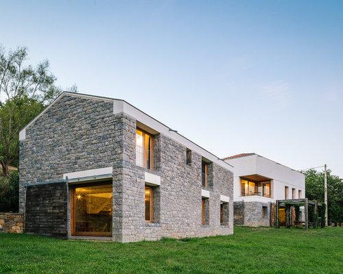 diseo de fachada gris de estilo de casa de campo grande de dos