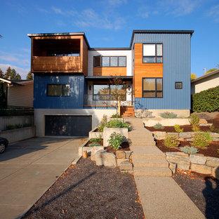 Diseño de fachada de casa multicolor, actual, grande, de tres plantas, con revestimientos combinados y tejado plano