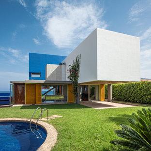 Diseño de fachada de casa multicolor, actual, de dos plantas, con tejado plano