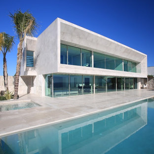Inspiration for a modern two-story flat roof remodel in Alicante-Costa Blanca