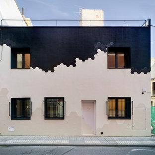 Foto de fachada de casa multicolor, minimalista, de tamaño medio, de dos plantas, con revestimientos combinados y tejado plano