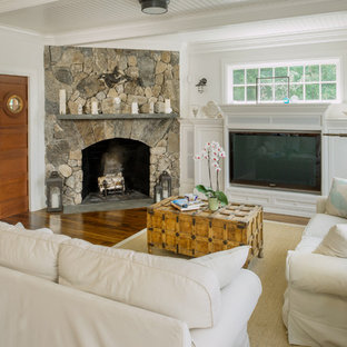 Example of a large beach style enclosed medium tone wood floor family room design in Providence with white walls, a standard fireplace and a stone fireplace