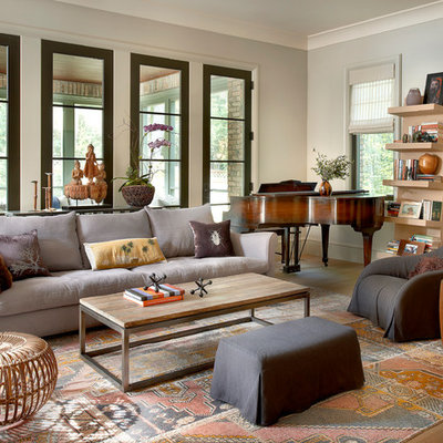 Large transitional open concept light wood floor family room photo in Chicago with gray walls and a music area