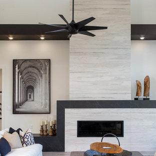 Immagine di un soggiorno industriale con pareti bianche e pavimento in gres porcellanato