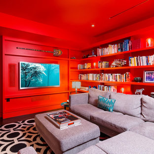 Example of a trendy enclosed dark wood floor family room design in Austin with red walls, no fireplace and a wall-mounted tv