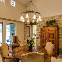 1425 Trebled Waters Trail, Driftwood, TX - Custom Ranch Style Home in Austin Texas Hill Country. Over 2,500 sf living area includes 4 bedrooms and 4 baths. The large kitchen has custom cabinets, concrete counter tops and faux stone floors. The open living/dining area features exposed wood beams, stone mantel, stone interior back wall and lots of windows. A rock fence and covered walkway leads to the detached 3 car garage with office/media room and upstairs balcony. Front entry features a large patio and garden. Back deck includes an outdoor dining area with a built in putting green. Property includes irrigation system.