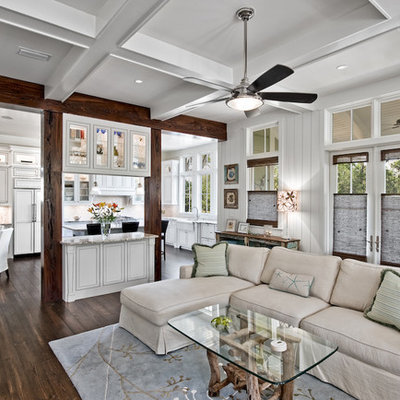 Family room - traditional open concept dark wood floor family room idea in Miami with white walls