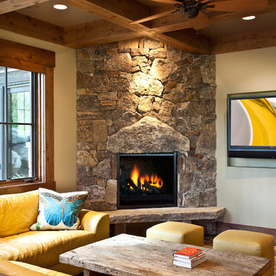 Family room - rustic family room idea in Salt Lake City with a corner fireplace