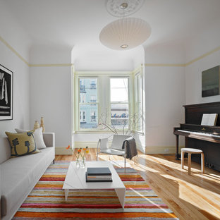 Inspiration for a large contemporary family room remodel in San Francisco with a music area, white walls, no fireplace and no tv