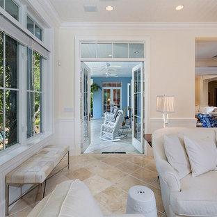 Exemple d'une salle de séjour exotique de taille moyenne et ouverte avec un mur beige, un sol en carrelage de céramique, une cheminée standard, un manteau de cheminée en carrelage, un téléviseur encastré et un sol beige.