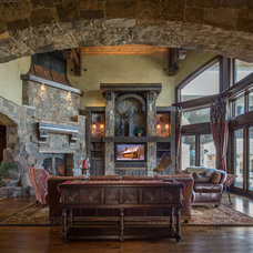 Rustic Family Room by Upland Development, Inc.