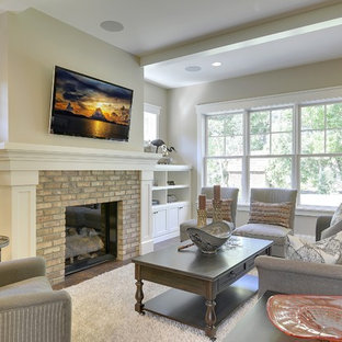 Family room - traditional family room idea in Minneapolis with beige walls