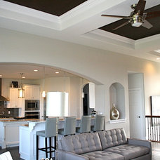 Transitional Family Room by Belman Homes