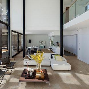 Foto di un grande soggiorno moderno stile loft con pareti bianche e pavimento con piastrelle in ceramica