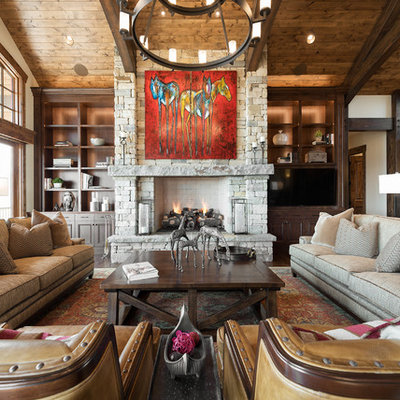 Family room - large rustic open concept dark wood floor family room idea in Salt Lake City with a standard fireplace, a stone fireplace, white walls and a media wall
