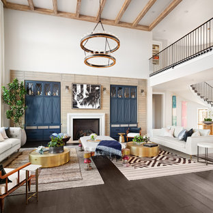 Inspiration for a transitional open concept dark wood floor and brown floor family room remodel in Portland with white walls and a standard fireplace