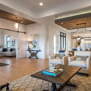 Example of a farmhouse family room design in Boise