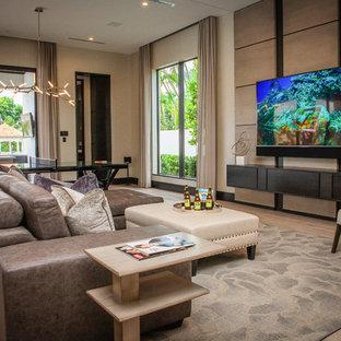 Идея дизайна: комната для игр в современном стиле с бежевыми стенами, паркетным полом среднего тона и телевизором на стене без камина